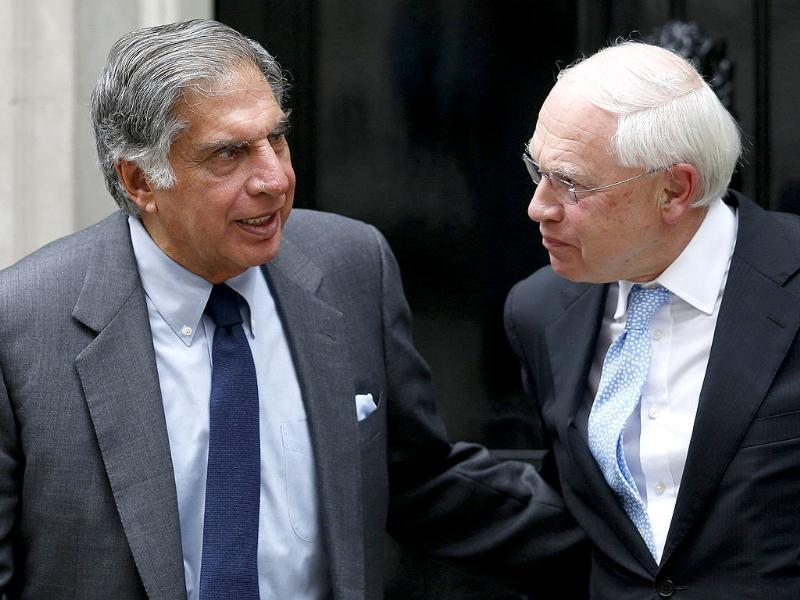 Tata Group chairman Ratan Tata and chairman of BAE Systems Richard Olver leave 10 Downing Street in London. Reuters
