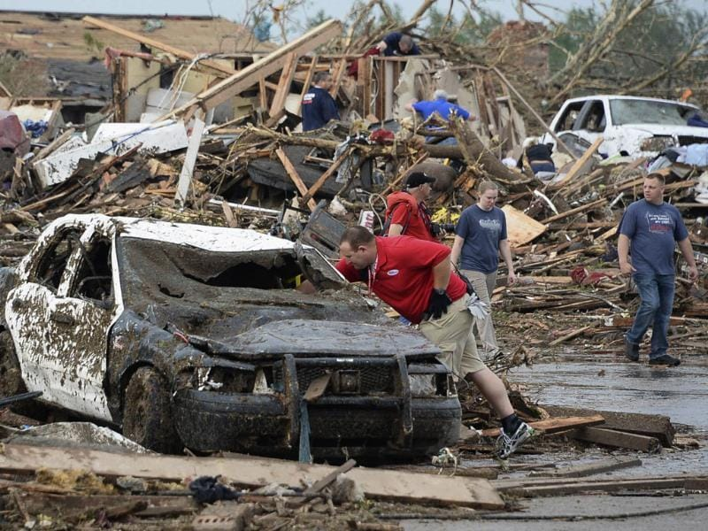A damaged police car is seen after a tornado struck Moore, Oklahoma. A 2-mile-wide (3-km-wide) tornado tore through the Oklahoma City suburb of Moore, destroying entire tracts of homes, piling cars atop one another, and trapping two dozen school children beneath rubble. Reuters