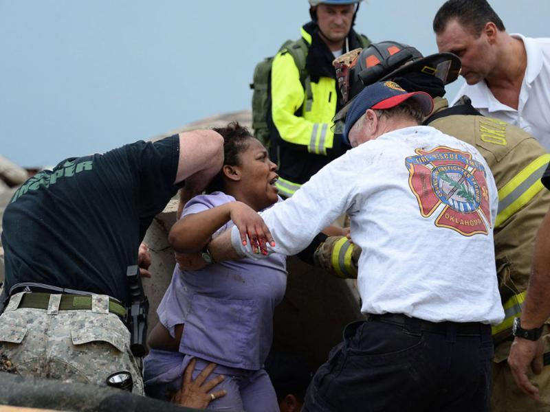 Rescue workers help free one of the 15 people that were trapped at a medical building at the Moore hospital complex after a tornado tore through the area of Moore, Oklahoma. Reuters