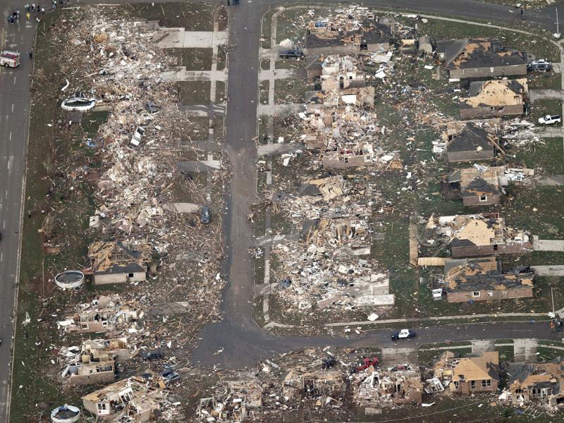 This aerial photo shows the remains of homes hit by a massive tornado in Moore, Oklahoma. A tornado roared through the Oklahoma City suburbs, flattening entire neighborhoods, setting buildings on fire and landing a direct blow on an elementary school. AP