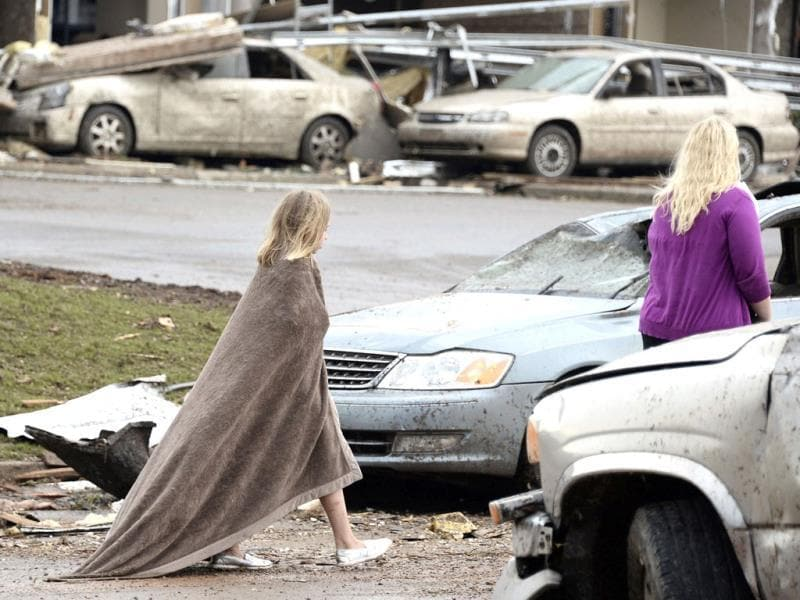 A girl walks, wrapped in a blanket, near the Moore Hospital after a tornado destroyed buildings and overturned cars in Moore, Oklahoma. Reuters photo