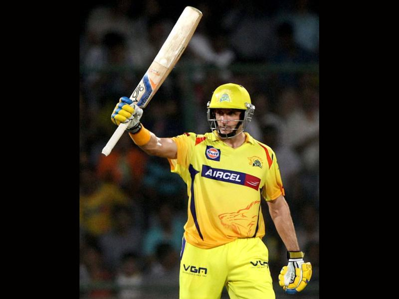 Chennai Super Kings M Hussey celebrates his fifty during T20's first qualifier against Mumbai Indians in New Delhi .PTI Photo by Shahbaz Khan