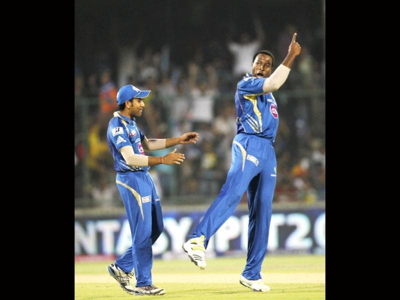 Mumbai Indians K Pollard celebrates the dismissal of Chennai Super Kings Murali Vijay during T20 Cricket tournament's first qualifier match between Chennai Supper Kings and Mumbai Indians at Feroz Shah Kotla ground in New Delhi. (Photo by Ajay Aggarwal/Hindustan Times)