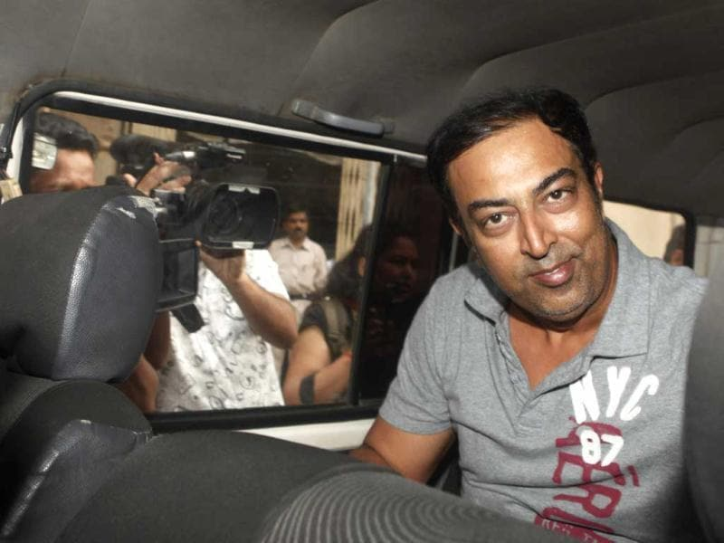Vindoo Dara Singh, son of late wrestler-actor Dara Singh, arrested in connection with the T20 spot-fixing scandal is produced at Esplanade Court in Mumbai. Hindustan Times/Kunal Patil