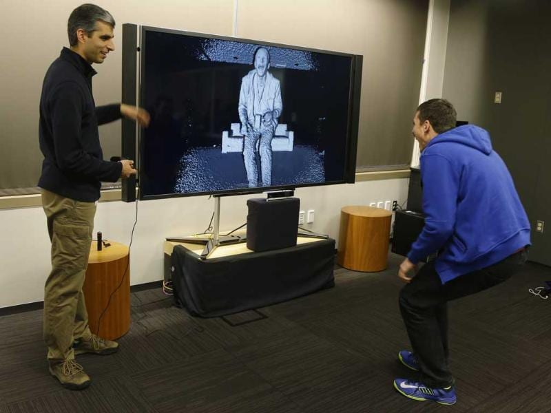 Kareem Choudhry, left, development manager for Microsoft Corp.'s Kinect motion-sensing device for the Xbox, demonstrates the level of detail in the camera of the new Kinect for the next-generation Xbox One entertainment and gaming console system to a visiting journalist, right, during a demonstration in Redmond, Wash. Photo: AP/Ted S. Warren