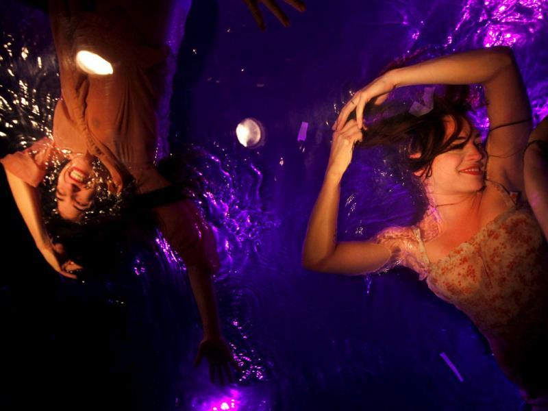 A dancer performs on a watery stage suspended above the audience during a dress rehearsal of the Fuerza Bruta (Brute Force) theatre group's stage production