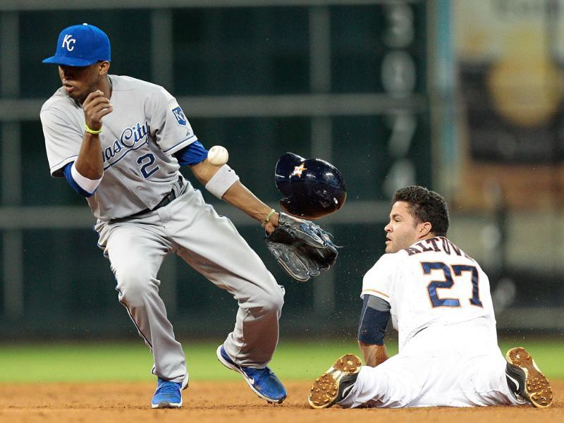 Jose Altuve #27 of the Houston Astros slides safely into second base as Alcides Escobar #2 of the Kansas City Royals cannot handle the throw in the eighth inning at Minute Maid Park in Houston, Texas. AFP/Getty Images