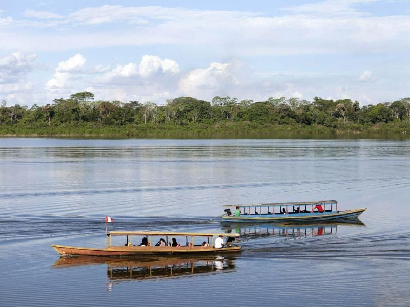 Motorboats cruise through the Yarinaqucha lagoon, near Peru's Amazon city of Pucallpa. Reuters