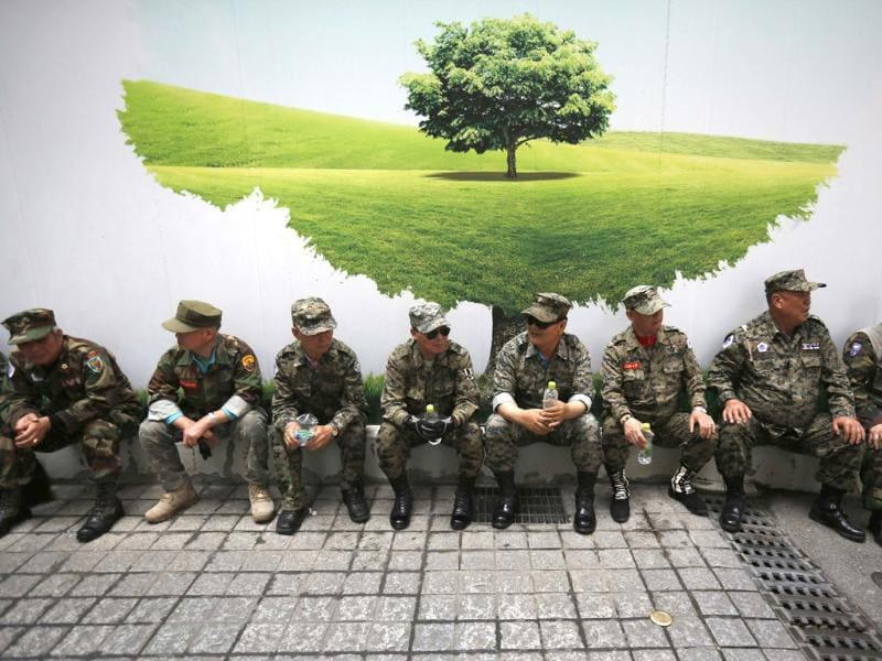 War veterans take a rest during an anti-Japan rally in front of Japanese embassy. The rally was held to denounce Abe and demand an official apology for Japan's war crimes during World War II. Reuters