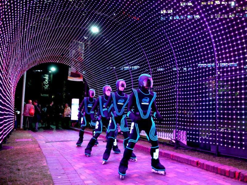 Rollerbladers glide through a light installation as landmarks around the city become part of Sydney's annual festival of light, music and ideas. (AFP)