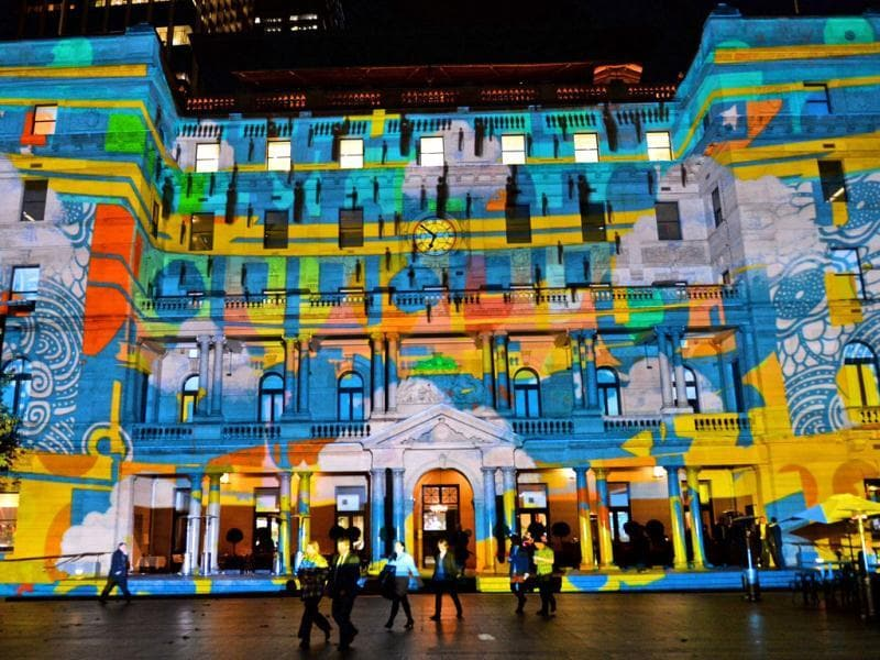 People walk past a light installation as landmarks around the city become part of Sydney's annual festival of light, music and ideas. (AFP)