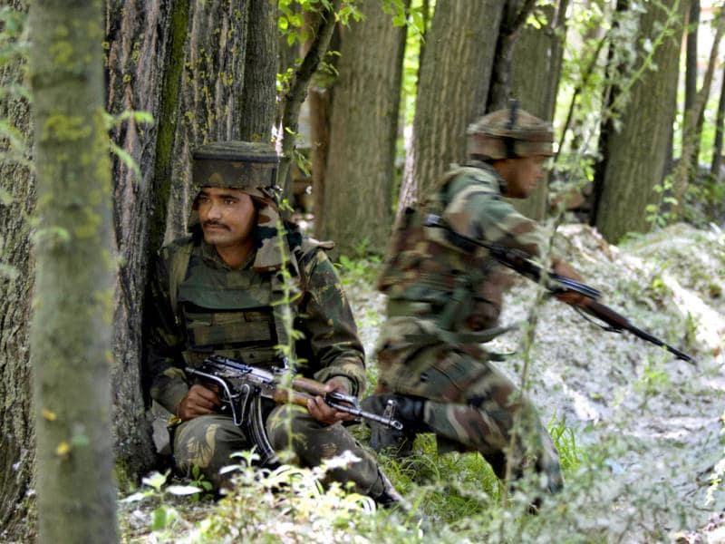 Indian Army soldiers take position during a gunbattle in Buchoo Balla, about 40 kilometers (25 miles) south of Srinagar. AP photo