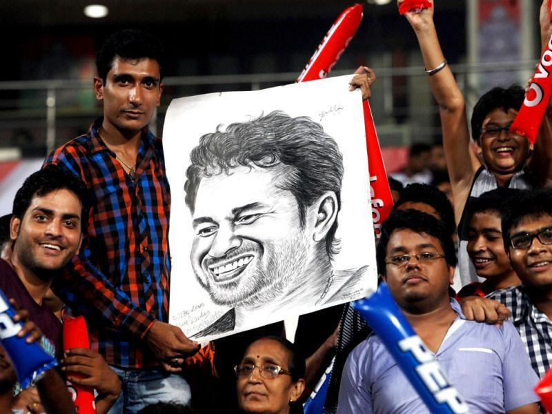 Sachin Tendulkar's fans hold his portrait during T20 semifinal match at Eden Garden in Kolkata .PTI photo/Swapan Mahapatra