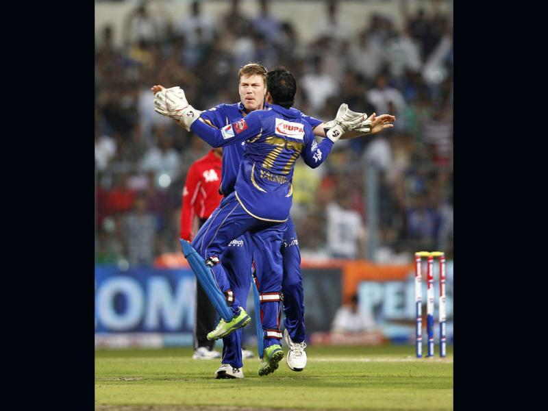 Rajasthan Royals James Faulkner being congratulated by Dishant Yagnik after he dismissed Mumbai Indians Kieron Pollard at Eden Gardens in Kolkata. HT photo/Ajay Aggarwal