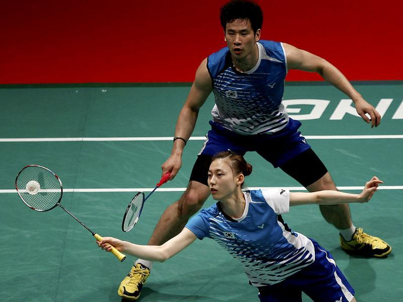 South Korea's Kim Ha-na returns a shot in front of her teammate Ko Sung-hyun against Thailand's Sudket Prapakamol and Saralee Thoungthongkam during their mixed doubles semifinal match at the Sudirman Cup world mixed team badminton championships in Kuala Lumpur, Malaysia. AP