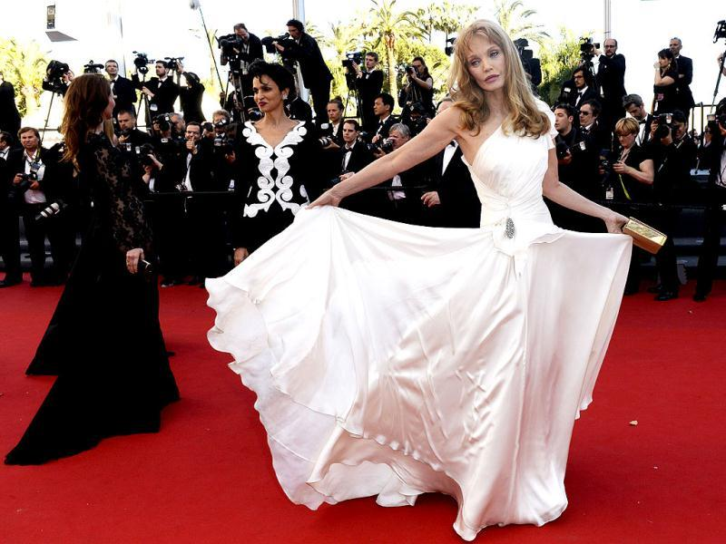 Arielle Dombasle floats in white
