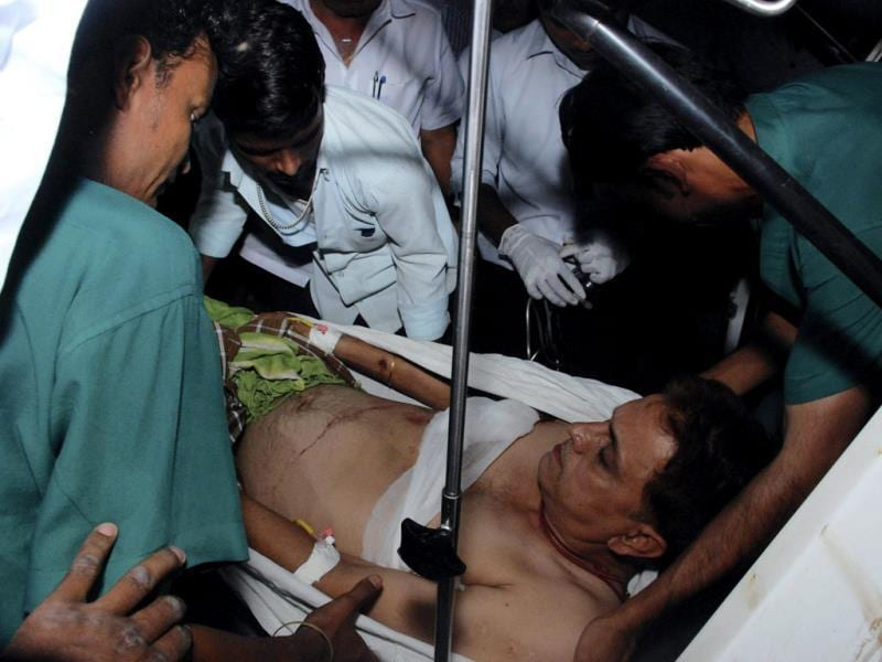 An injured person being hospitalised after Naxals attacked Congress rally in Chhattisgarh. PTI Photo