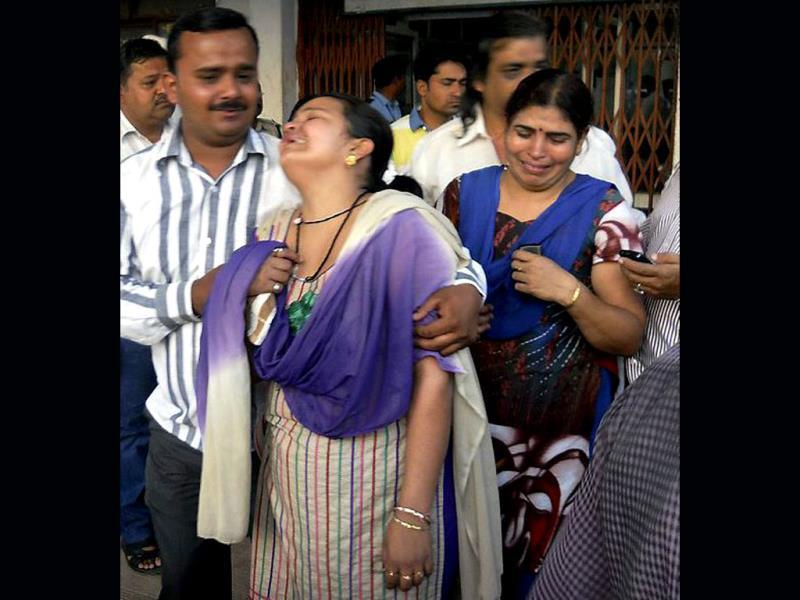 Grieving relatives of an injured at a hospital in Raipur after the Naxal attack in Chhattisgarh on Saturday. PTI Photo