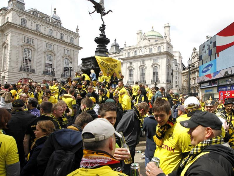 Boussia Dortmund's supporters gather at Piccaddily Circus as supporters of Boussia Dortmund and Bayern Munich arrive in central London ahead of their Champions League final soccer match at Wembley Stadium on Saturday. AP Photo