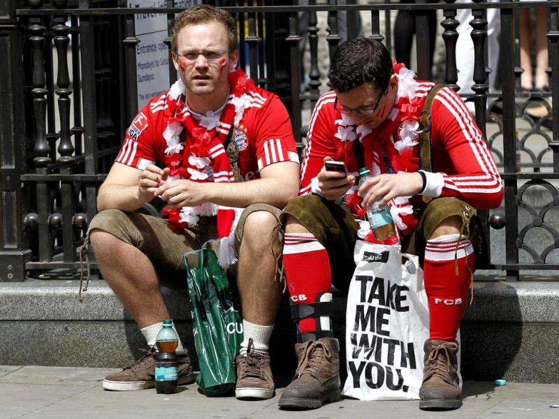 Two Bayern Munich supporters take a rest in Piccadilly Circus as supporters of Boussia Dortmund and Bayern Munich gather in central London ahead of their Champions League final soccer match at Wembley Stadium on Saturday. AP Photo
