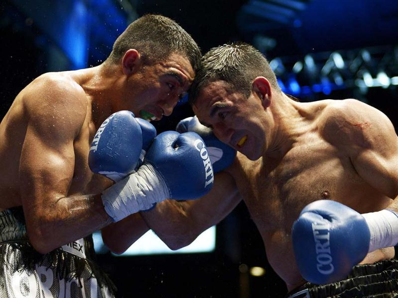 World Boxing Council super flyweight defending champion Omar Narvaez (R) of Argentina and challenger Felipe Orucuta of Mexico trade punches during their title bout at Luna Park stadium in Buenos Aires, Argentina. Narvaez won to keep the title. (AFP)