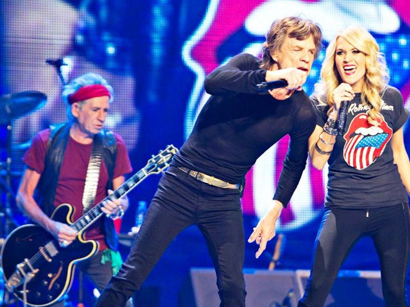 Mick Jagger (C) and Keith Richards of the Rolling Stones perform with Carrie Underwood during The Rolling Stones 50 and Counting tour at the Air Canada Centre in Toronto. (Reuters)