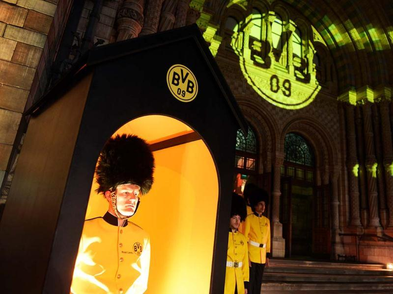 Actors in mock uniforms guard Borussia Dortmund's party at the Natural History Museum in London, England. Borussia Dortmund lost the Champions League final soccer match against FC Bayern Munich at Wembley stadium in London. (AP)