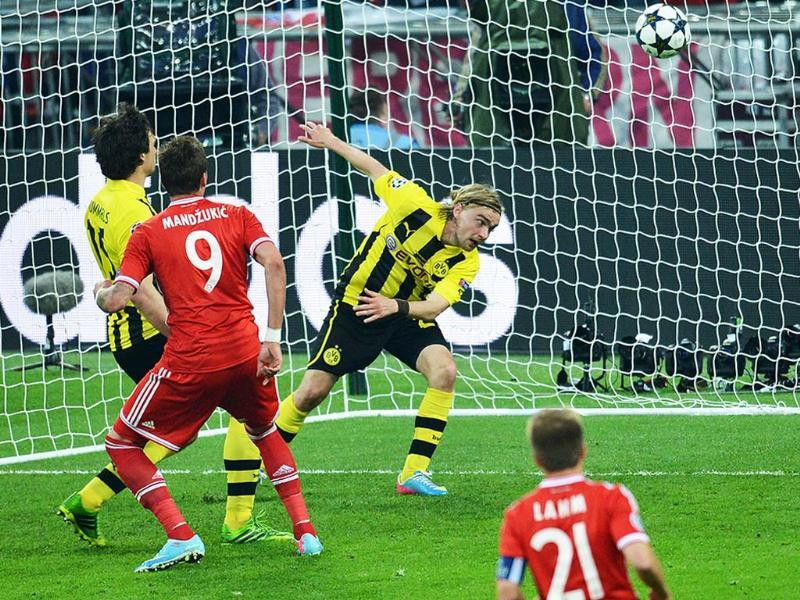 Bayern Munich's Croatian striker Mario Mandzukic scores his team's opening goal during the UEFA Champions League final football match between Borussia Dortmund and Bayern Munich at Wembley Stadium in London. AFP
