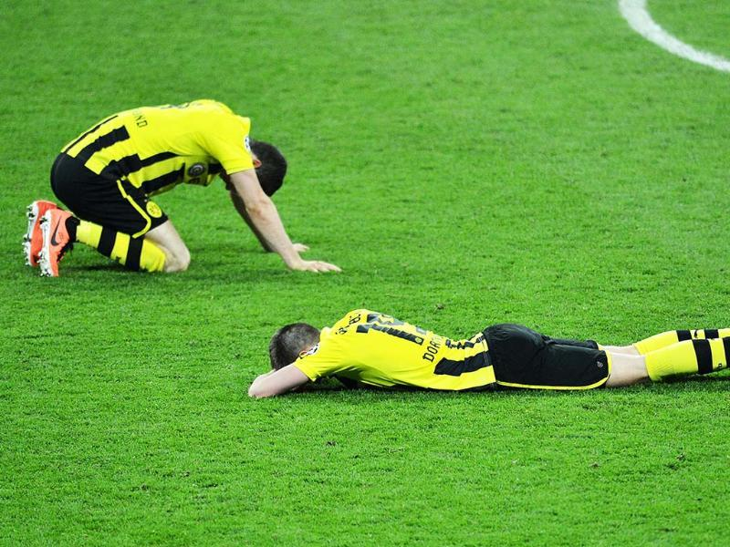 Borussia Dortmund's players react after their defeat in the UEFA Champions League final football match between Borussia Dortmund and Bayern Munich at Wembley Stadium in London. AFP