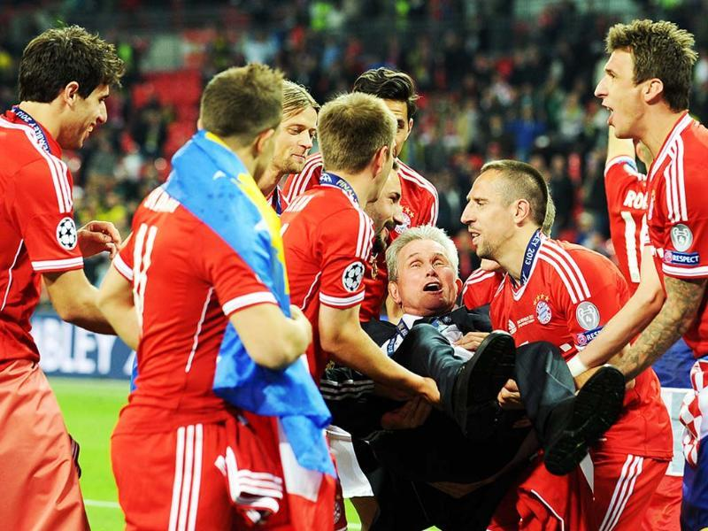 Bayern Munich's German Head Coach Jupp Heynckes is lifted up by his players after their victory in the UEFA Champions League final football match between Borussia Dortmund and Bayern Munich at Wembley Stadium in London. AFP