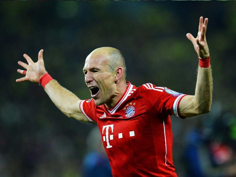 Bayern Munich's Dutch midfielder Arjen Robben celebrates at the final whistle after their victory in the UEFA Champions League final football match between Borussia Dortmund and Bayern Munich at Wembley Stadium in London. AFP