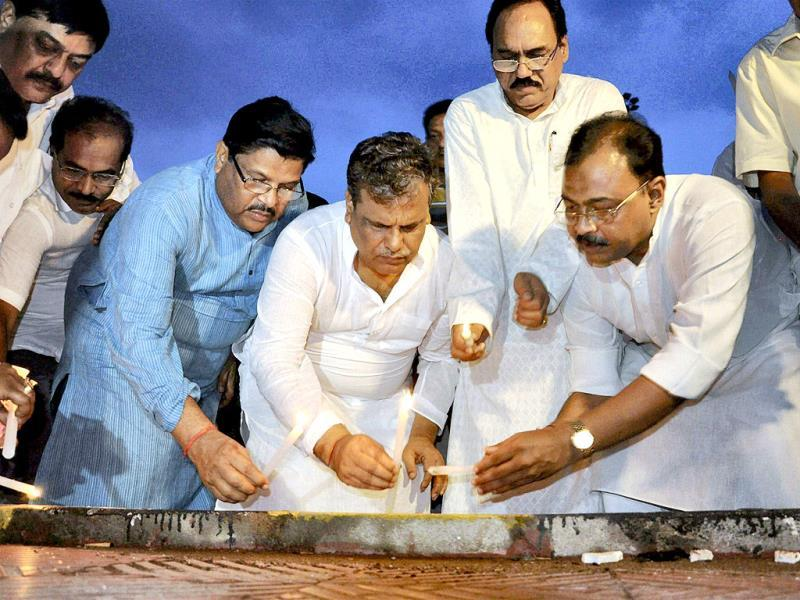 Congress party leaders in Bhubaneswar light candles to pay homage to the victims of the maoists attack on Congress party's convoy in Chhattisgarh. PTI Photo