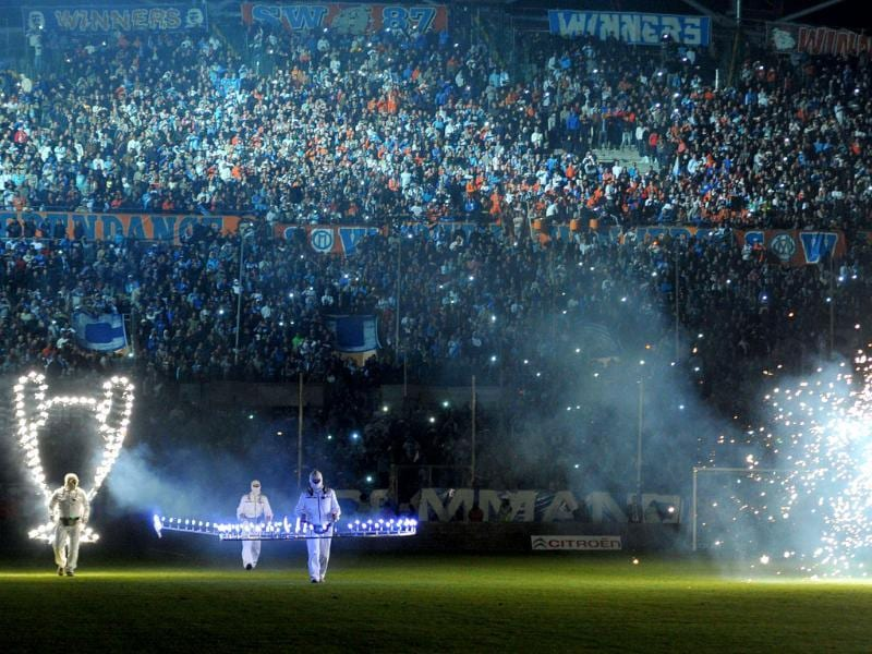 Marseille's fans watch a fireworks show during a celebration to mark the anniversary of OM's 1993 UEFA Champions League title at the Velodrome stadium in Marseille, southeastern France. AFP