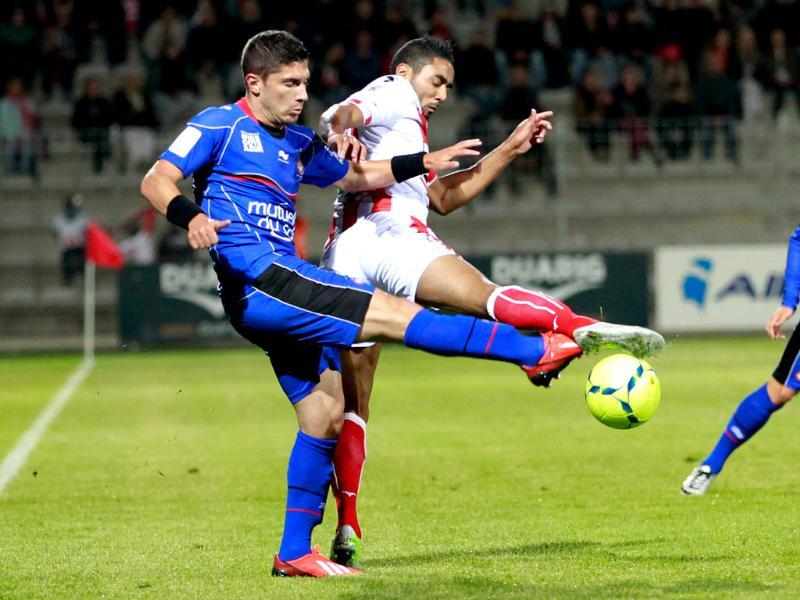 Nice's French defender Gregoire Puel vies for the ball Ajaccio's Franco-Moroccan midfielder Chahir Belghazouani during the French Ligue1 football match Ajaccio vs Nice in the Francois Coty stadium in Ajaccio, Corsica. AFP