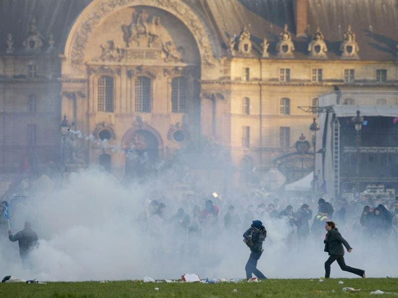 Protesters stand in tear gas smoke in Paris on the sidelines of demonstrations against a gay marriage law. France on May 18 became the 14th country to legalise same-sex marriage after President Francois Hollande signed the measure into law following months of bitter debate and demonstrations. AFP