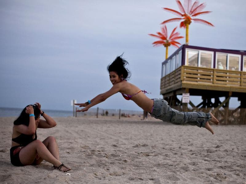Kathyn S. jumps as she plays with friends at Point Pleasant Beach on the first weekend of New Jersey beaches re-opening to the public in Point Pleasant, New Jersey. AFP photo