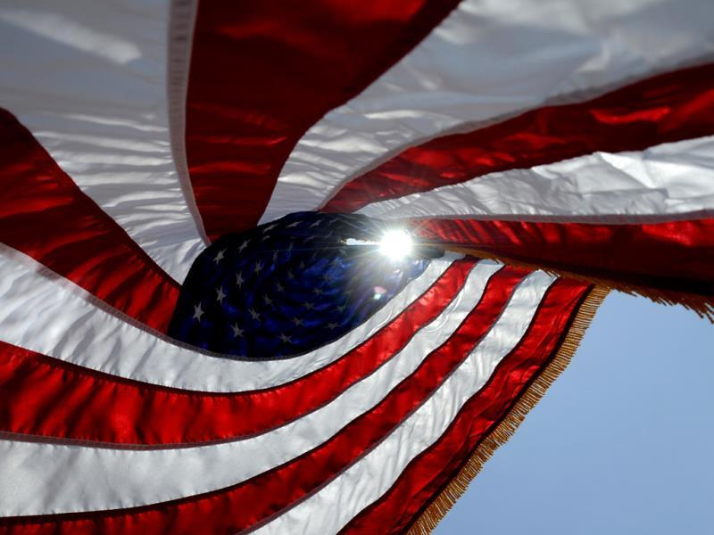 The sun shines through an American flag outside the Montgomery VA Medical Center of the Central Alabama Veterans Healthcare System in Montgomery on Memorial Day. AP photo