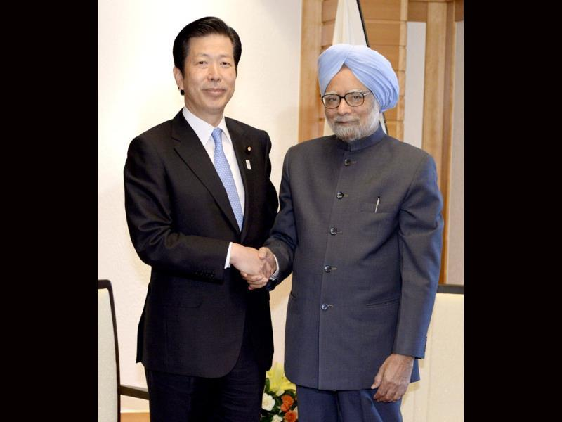 Prime Minister Manmohan Singh, right, poses with Natsuo Yamaguchi, the leader of the New Komeito, part of Japanese ruling coalition, during their meeting at a hotel in Tokyo. AP photo