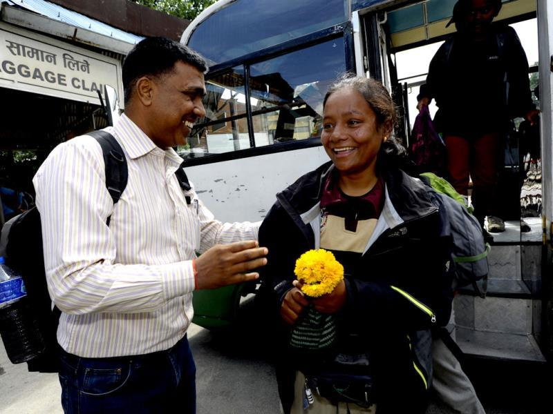Indian mountaineer Arunima Sinha, (R) who had her leg amputated below the left knee two years ago, is welcomed by her brother on her arrival at Tribhuvan Airport in Kathmandu. AFP photo