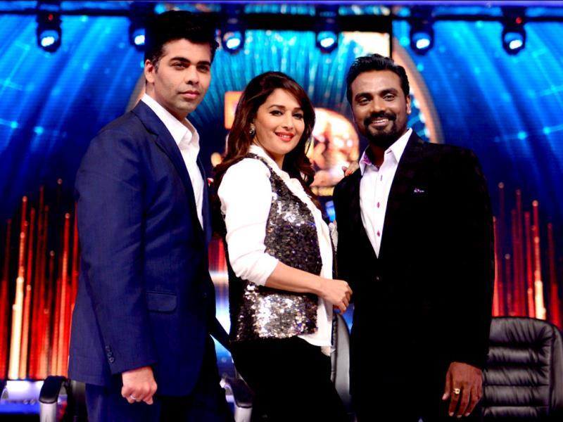 Madhuri flanked by co-judges Karan Johar and Remo on the sets of Jhalak Dikhhla Jaa, one of the most popular dance shows on Indian TV.