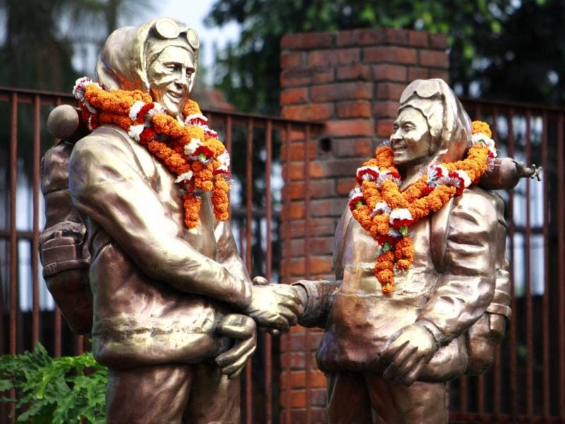 Statues of Sir Edmund Hillary of New Zealand, and Tenzing Norgay Sherpa (R), the first climbers to conquer Mount Everest in 1953, are decorated with garlands during the 60th anniversary of their ascent, in Kathmandu. REUTERS