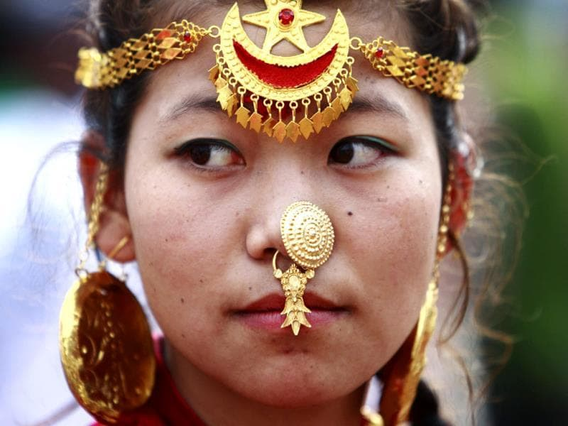 A woman wearing traditional ornaments participates in a parade marking the 60th anniversary of Sir Edmund Hillary and Tenzing Norgay Sherpa's conquest of Mount Everest, in Kathmandu. REUTERS