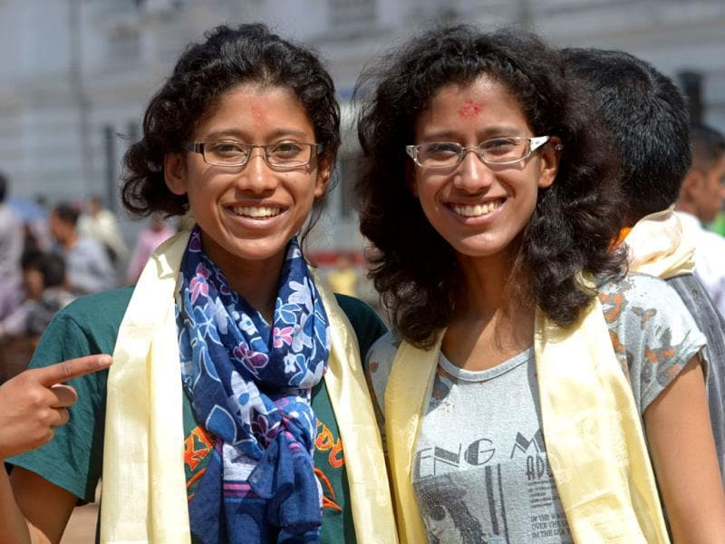 Indian mountaineers Tashi and Nancy Malik, noted for being the first twin sisters to summit Everest earlier this month, pose while participating in a procession for Everest summitteers during the Mount Everest Diamond Jubilee celebrations in Kathmandu. AFP PHOTO