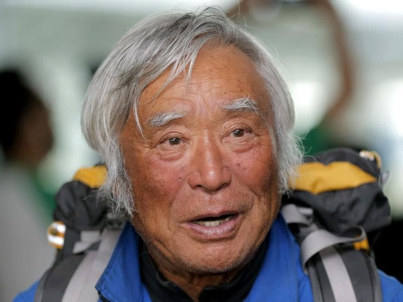 80-year-old Japanese climber Yuichiro Miura, who became the oldest conqueror of Mount Everest, speaks to media upon his arrival at Haneda International Airport in Tokyo. Miura, a Japanese former extreme skier, conquered the mountain on May 23 despite undergoing heart surgery in January for an irregular heartbeat, or arrhythmia, his fourth heart operation since 2007. He also broke his pelvis and left thigh bone in a 2009 skiing accident. AP Photo