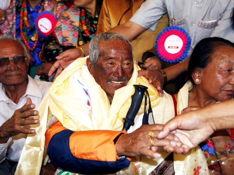 In this May 31, 2008 file photo, Min Bahadur Sherchan, center, who became the oldest person to climb Mount Everest on May 25, 2008, shakes hands on his arrival in Katmandu, Nepal. The 81-year-old Nepalese man has abandoned his attempt to climb Mount Everest, leaving Japanese mountaineer Yuichiro Miura with the record as the oldest person to scale the world's highest mountain. AP Photo