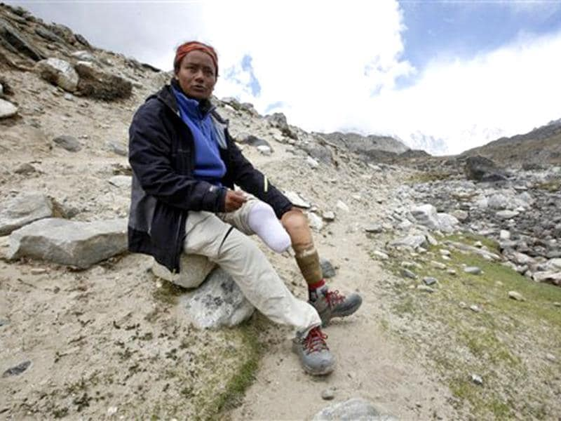 In this May 25, 2013 photo, Arunima Sinha who became India's first amputee woman to conquer Mount Everest on a prosthetic leg poses for photographs at Lobuche, Nepal. A former Indian volleyball player, Arunima lost her left leg when she was thrown off a moving train two years ago. AP Photo