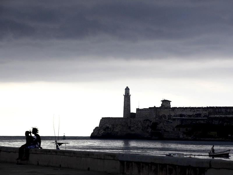 Storm clouds gather in the sky as a fishing boat enters Havana's port near Spanish colonial-era fortress El Morro. Reuters photo