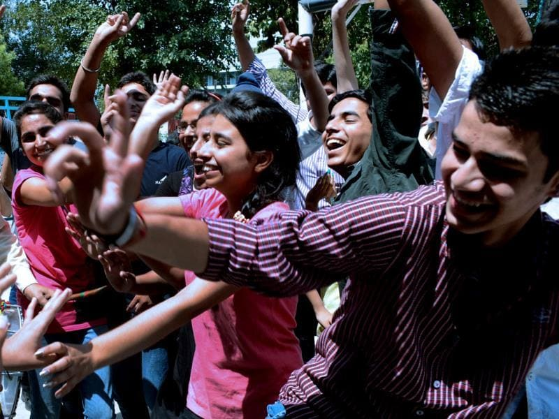 Students dance at Ram Ashram Public School in Amritsar as they celebrate their results from The Central Board of Secondary Education (CBSE) Class 10 examinations. AFP photo