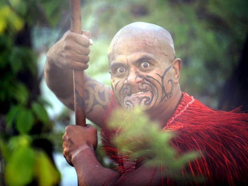 A Maori in traditional clothing performs during the inauguration of the garden 'Te Putake' dedicated to Maori culture in Les Jardins Fruitiers (fruit gardens) in Laquenexy, eastern France. The garden is the first outside of New Zealand to be dedicated to the Maori culture. AFP