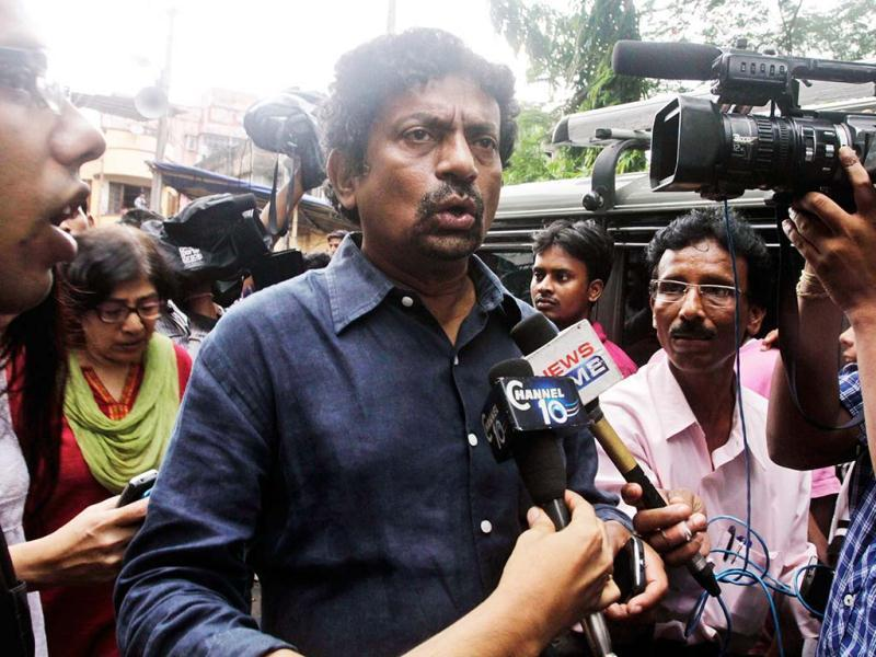 Indian film director Gautam Ghosh speaks as he arrives to pay homage to late director Rituparno Ghosh in Kolkata, India, Thursday, May 30, 2013. Ghosh, whose work includes award-winning films in the Bengali language, died Thursday of cardiac arrest at age 49, news reports said. (AP Photo)